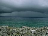 Dark Clouds Foretell a Storm Approaching Cuba's Rocky Coastline Photographic Print by Steve Winter