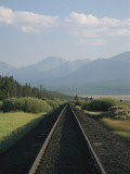 View Down Railroad Tracks Near Leadville, Colorado Photographic Print by Richard Nowitz