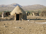Shelters Made Out of Cow Dung and Sticks by the Himba Tribespeople Photographic Print by Joy Tessman