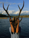 Burmese Man Holding Up a Pair of Sambar Deer Antlers Photographic Print by Steve Winter