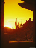 View Through a Hotel Window of a Desert Landscape at Sunset Photographic Print by Richard Nowitz