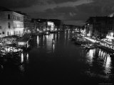 Black and White Photograph of Grand Canal From Rialto Bridge at Night Photographic Print by Todd Gipstein