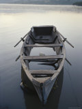 Timeworn Boat Rests on a Calm Lake Photographic Print by Raul Touzon