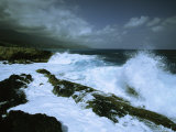 Surf Pounds on One of Cuba's Rocky Coastlines Under a Stormy Sky Photographic Print by Steve Winter