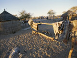San Bushman Village of Thatch Huts Photographic Print by Joy Tessman