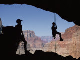 Woman Rappels Off of a Rock Near the Little Colorado River Photographic Print by John Burcham