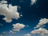 White, Fluffy Clouds Fill the Blue Sky Above Arizona Photographic Print by John Burcham