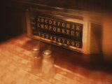 Tableside Jukebox and Salt and Pepper Shakers on a Table in a Diner Photographic Print by Todd Gipstein