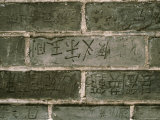 Chinese Graffiti Carved into Bricks on the Great Wall of China Photographic Print by Todd Gipstein