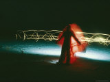 Time Lapse Photo of Man Draped in Red Cloth and Squiggly Lights Photographic Print by Steve Winter
