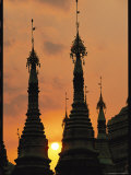 Silhouetted Spires of a Buddhist Temple at Twilight Photographic Print by Steve Winter