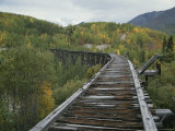 Ruins of the Gilahina Trestle Bridge on the Copper River Railway Photographic Print by George Herben