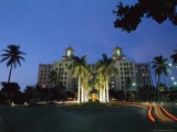 Twilight View of Building with Palm Trees in Cuba Photographic Print by Steve Winter