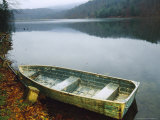 Old Rowboat on the Shore of Douthat Lake in Rain Photographic Print by Raymond Gehman