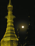 Night View of the Moon and an Ornate Spire on a Building Photographic Print by Steve Winter