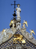 Crucifix and Statue Atop St. Mark's Basilica in Venice Photographic Print by Rex Stucky