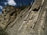 Vertically Bedded Sedimentary Rock Along the Dempster Highway Photographic Print by George Herben