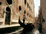 Gondolier Poles Through the Canals of Venice Photographic Print by Rex Stucky
