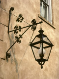 Iron Street Lamp Hangs From a Historic Building Photographic Print by Rex Stucky