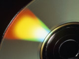 Close View of a Compact Disc Reflecting Rainbow Colors Photographic Print by Taylor S. Kennedy