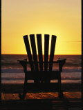 Lawn Chair on a Beach at Sunset Photographic Print by Steve Winter