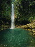 Water Runs Out of a Cave and Forms a Waterfall Photographic Print by Stephen Alvarez