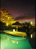 Night View with Venus of Modern Hotel with Swimming Pool Photographic Print by Steve Winter