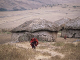 Maasai Child Running Up Hillside from Village Just Outside Ngorongoro Crater Photographic Print by Judy Bellah