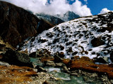 Stream and Snow-Covered Hillside at the Village of Machhermo Photographic Print by Richard I'Anson