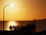 People on the Pier at Sunset, Hokianga Harbour Photographic Print by Holger Leue
