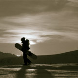 Silhouetted Snowboarder Hiking Photographic Print by Christian Aslund