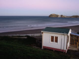 Beach Hut and Castlepoint Lighthouse at Dusk, Castlepoint Photographic Print by Holger Leue