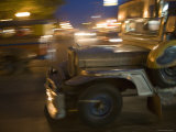 Jeepney Speeds Through Night in Malate Photographic Print by Greg Elms