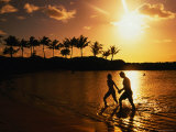 Couple on Beach at Sunset Photographic Print by Linda Ching
