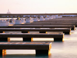 Rows of Docks in Frozen Harbour with Lighthouse in Background Photographic Print by Charles Cook