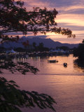 Sunset over Passenger Sampans on Sarawak River Photographic Print by John Borthwick