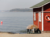 Rescue Hut with Boat, Lifebelt on Pihlajasaari Island Photographic Print by David Borland
