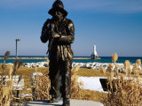 Fishermen's Monument Statue with Lighthouse on Lake Michigan Photographic Print by Charles Cook
