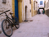 Bicycle in Streets of Essaouira's Medina Photographic Print by Olivier Cirendini