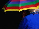 Woman Holding Umbrella Photographic Print by Rick Rudnicki