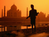 Silhouetted Fisherman by Yamuna River with Taj Mahal in Background Photographic Print by Paolo Cordelli