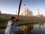 Boatman Poling across Yamuna River at Sunrise in Front of Taj Mahal Photographic Print by Michael Gebicki