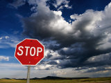 Stop Sign on Plains with Clouds Above Photographic Print by Ray Laskowitz