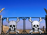 Skull and Crossbones Motifs at Park Entrance Photographic Print by Pascale Beroujon