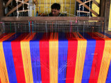 Man Weaving Cloth Photographic Print by Uros Ravbar