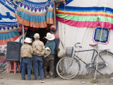 Boys Peering into Traditional-Style Tibetan Tent to View a Video at Gyantse Horse-Racing Festival Photographic Print by Tim Hughes