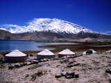 Yurts Beside Kara Kul Lake with Snow-Capped Muztagh Ata Mountain in Background Photographic Print by Lindsay Brown