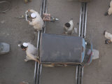 Overhead View of Men Pushing Rickshaw across Train Lines Photographic Print by Gavin Quirke