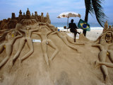 Sand Sculptures with the Sculptor Posing under the Umbrella, Copacabana Photographic Print by Judy Bellah