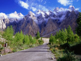 Road of the Karakoram Highway Leading Towards Cloud-Swathed Mountains Photographic Print by Lindsay Brown